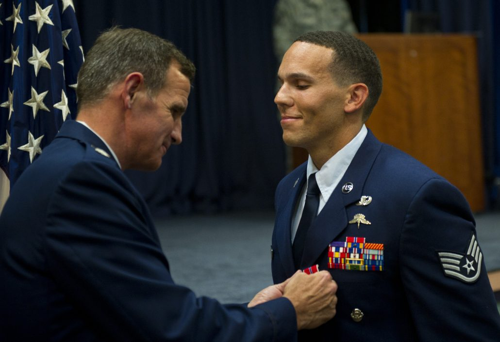 From right, U.S Air Force Staff Sgt. Johnnie Yellock Jr., a combat controller with the 23rd Special Tactics Squadron, stands at attention as Lt. Col. Chris Larkin, 23rd STS commander, presents him the Bronze Star Medal June 26, 2012 at Hurlburt Field, Fla. Yellock received the Bronze Star for his deployment to Afghanistan in 2011 -- a deployment in which he was significantly wounded by an Improvised Explosive Device. (U.S. Air Force photo by Staff Sgt. David Salanitri)